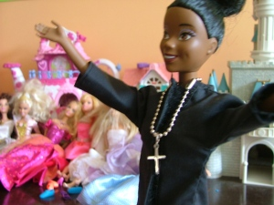 """My daughter's Barbie in clergy stole helps her play """"church.""""  Last weekend, the Barbie did a funeral for a tadpole that died before its time."""