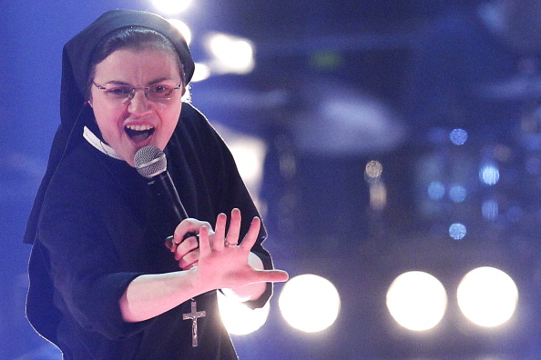 "Sister Cristina Scuccia performs during the Italian State RAI TV show final ""The Voice of Italy"" in Milan on June 5, 2014. The 25-year-old nun is already a talent show sensation thanks to her habit-clad performances but also has on her side the critics, who say her popularity stems from novelty value.  AFP PHOTO / MARCO BERTORELLO        (Photo credit should read MARCO BERTORELLO/AFP/Getty Images)"