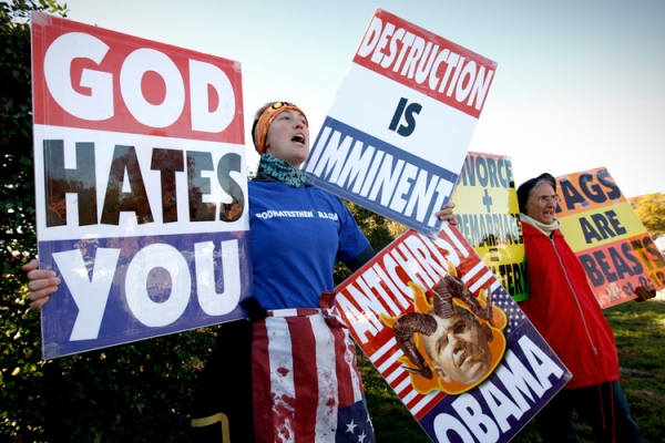 Members of the Westboro Baptist Church hold anti-gay signs at Arlington National Cemetery in Virginia on Veterans Day, November 11, 2010. REUTERS/Kevin Lamarque (UNITED STATES - Tags: POLITICS) - RTXUI58